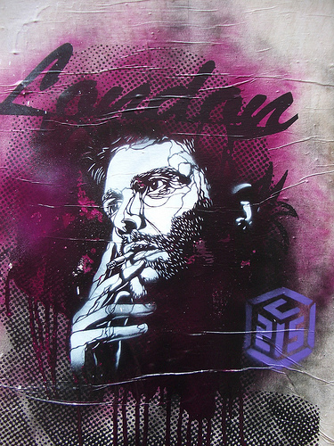 C215 wheatpaste in the street