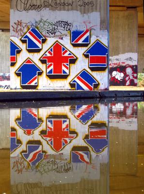 Above street art arrow in UK